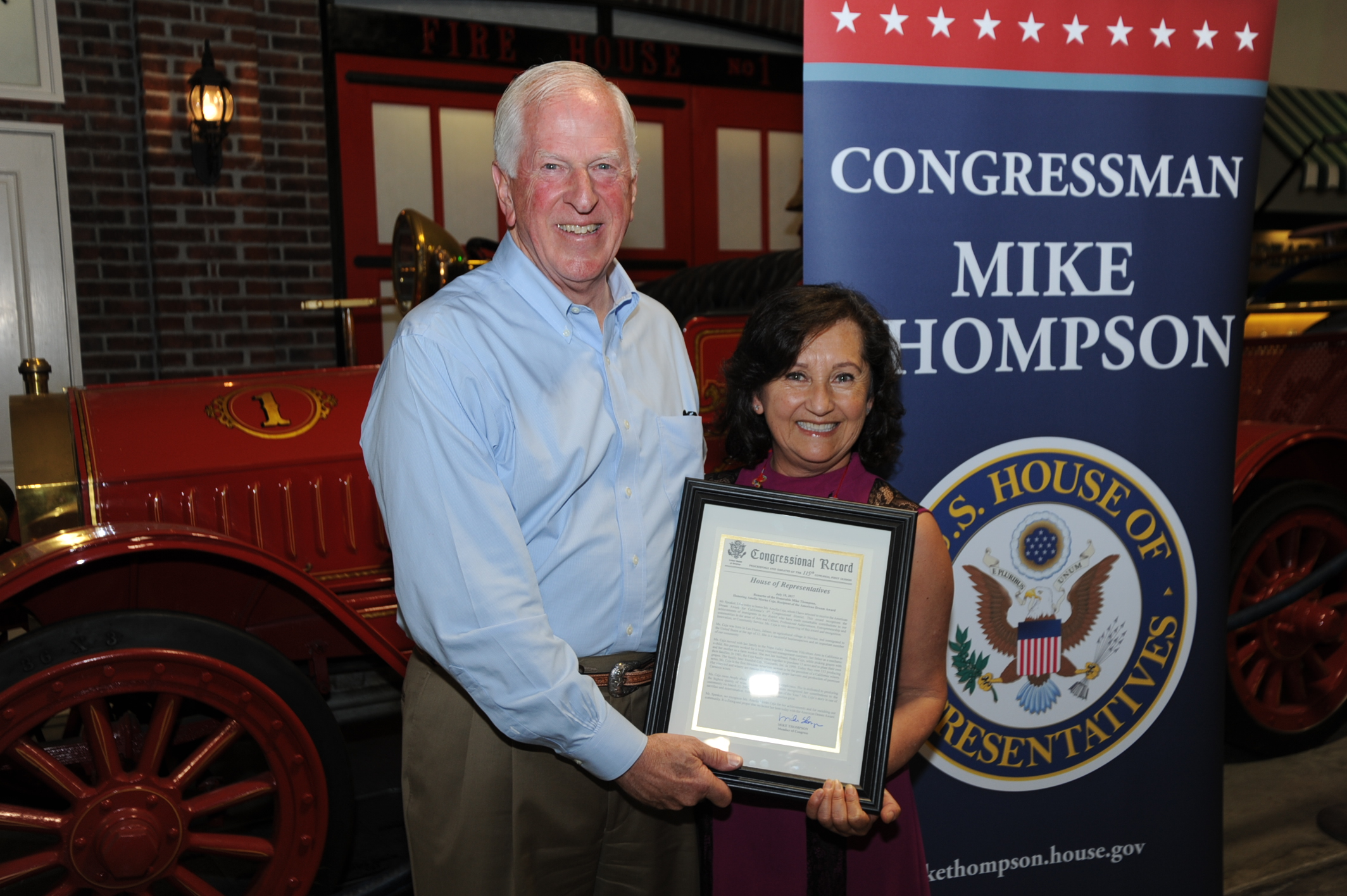 Rep. Thompson presents a My American Dream Award to Amelia Ceja.