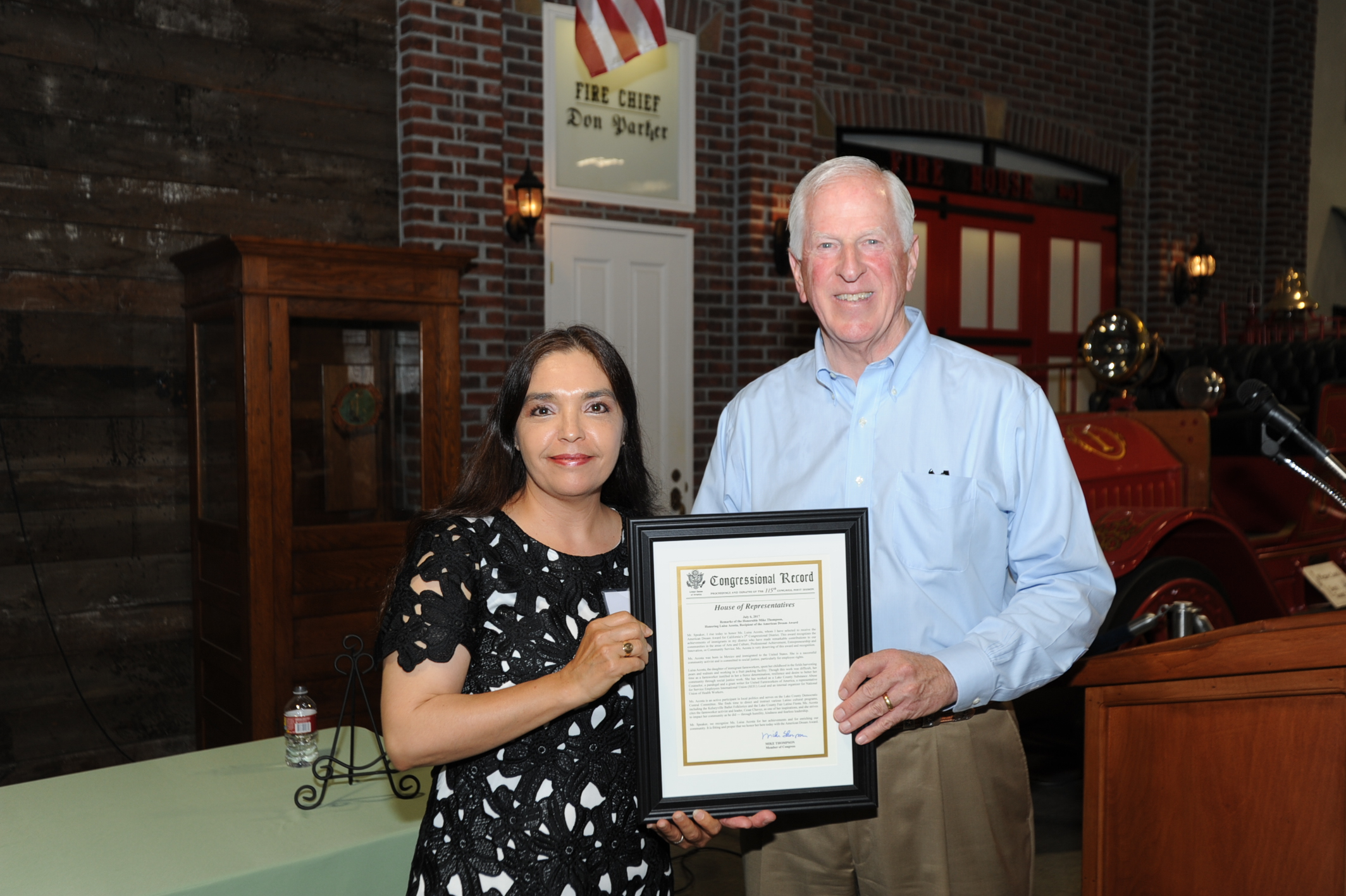 Rep. Thompson presents a My American Dream Award to Luisa Acosta.
