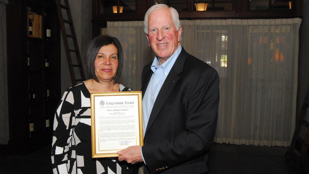 Rep. Thompson presents a certificate of Congressional recognition to Villa-Serrano.
