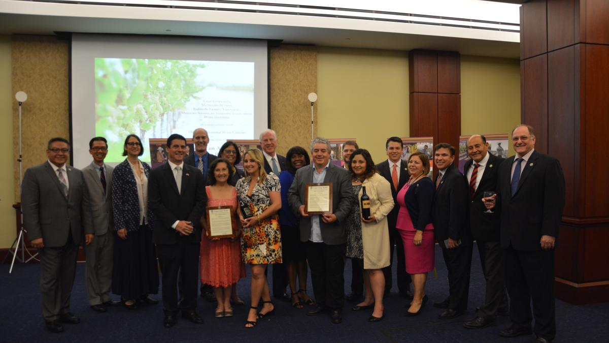 Thompson, Members of Congress present Ceja Vineyards and Mi Sueño Winery with certificates of Congressional Recognition.