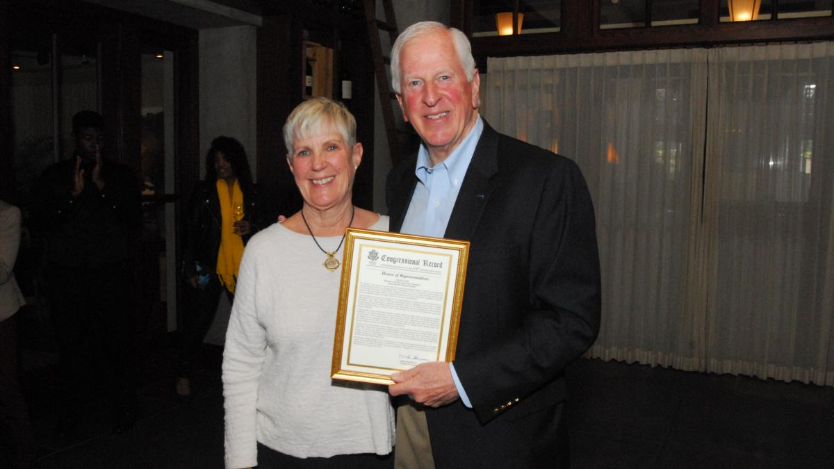 Rep. Thompson presents a certificate of Congressional recognition to Mondavi's daughter, Annie Roberts.