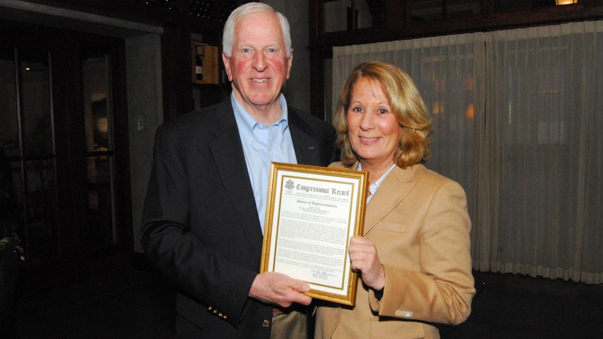 Rep. Thompson presents a certificate of Congressional recognition to Cakebread.