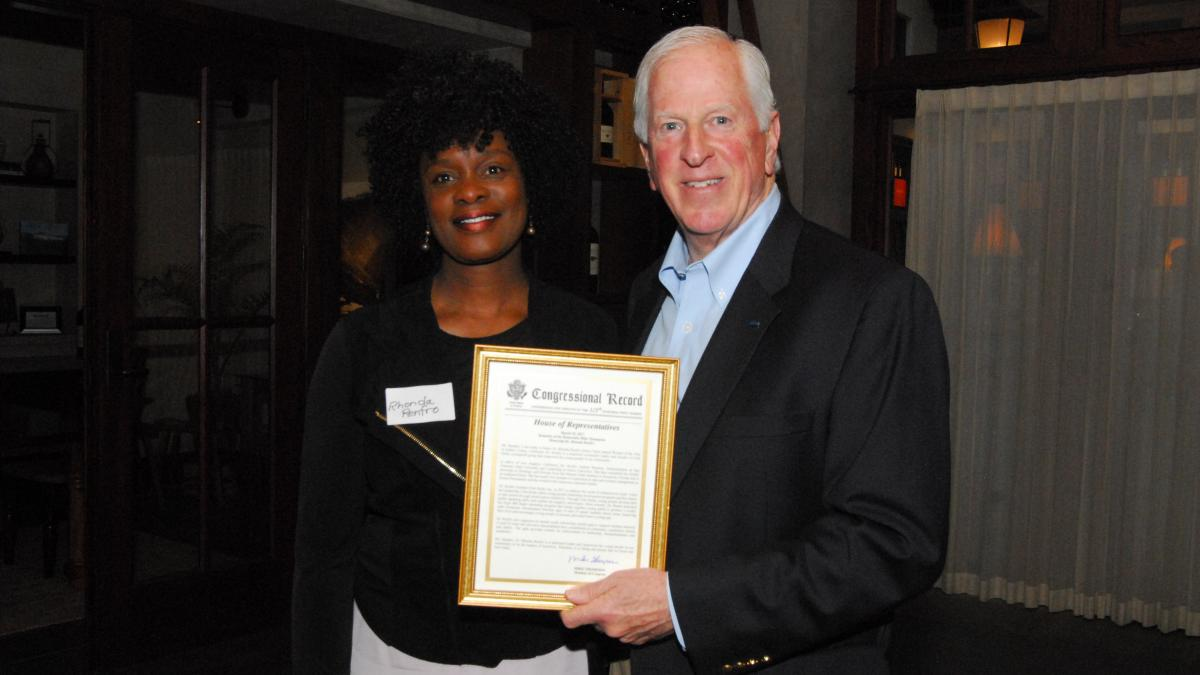 Rep. Thompson presents a certificate of Congressional recognition to Dr. Renfro.
